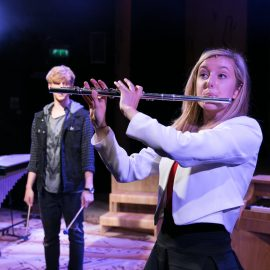 Caroline Whittingham plays the flute as Harry Al-Adwani looks on 4